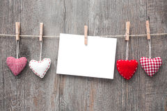 Message and red hearts on the clothesline Stock Image