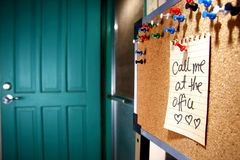 Message or reminder board with call me at the office note royalty free stock photography