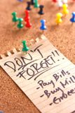Message or reminder board with don't forget note. Photo of a cork, message or reminder board with a note saying don't forget Royalty Free Stock Images