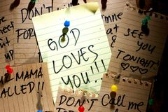 Message or reminder board with God loves you note. Photo of a cork, message or reminder board with a note saying God loves you Royalty Free Stock Photography