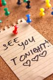 Message or reminder board with see you tonight note Stock Photo