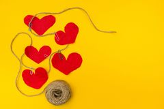 The message on the rope for mom from a small child. A lot of hearts on a yellow background stock images