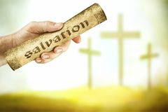 The message of salvation from the cross. A hand that shows the message of salvation from the cross of the Lord Jesus. For the grace of God that bringeth Royalty Free Stock Images