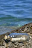 Message on the shore. Message in a bottle on the shore Royalty Free Stock Images