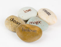 Message stones. Create, magic, believe, dream, and love message stones isolated on a white background Royalty Free Stock Photos