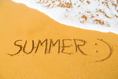Message Summer :) written in sand Royalty Free Stock Photography