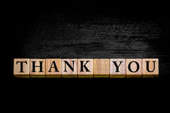 Message THANK YOU isolated on black background Stock Image