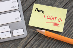 Message to boss about resignation. Written on a note Stock Photo