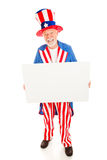Message From Uncle Sam. Realistic Uncle Sam holding a blank white sign ready for your text. Isolated on white stock photography
