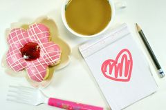 Yummy Donut, lovely notepad and coffee stock images