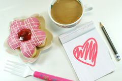 Yummy Donut, lovely notepad and coffee stock photo