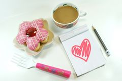 Yummy Donut, lovely notepad and coffee royalty free stock image