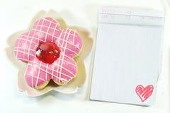 Yummy Donut, lovely notepad royalty free stock photography
