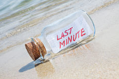 Message in a vintage bottle Last minute on beach. Royalty Free Stock Photo