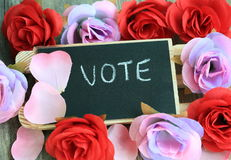 Message of vote with flowers in the background Stock Photo