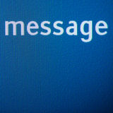 Message word. On a digital pixelated display. Close-up with large copy space Stock Photos