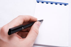 Message write - hand writing on blank notepad Stock Photography