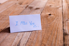 Message writing on the paper placed on the wooden background Royalty Free Stock Images