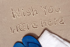 Message written on sand Stock Photos