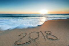 2018 message written in the sand. On the beach Stock Photography