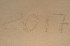2017, a message written in the sand at the beach. Royalty Free Stock Photography