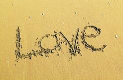 Message written on sand Stock Photos