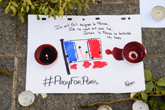 Messages, candles and flowers in memorial for the victims. STRASBOURG, FRANCE - NOV 16, 2015: French Flag, messages, candles and flowers are left around General stock photo