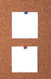 Messages on cork board. Two message papers pinned to cork board Stock Image