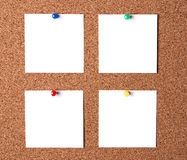 Messages on cork board. Several message papers pinned to cork board Stock Images