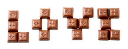 Messages d'amour avec des bonbons au chocolat Photos stock