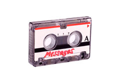 Messages on tape. Cassette tape from answering machine over white background with clipping path stock photos