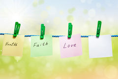 Messages written on a paper on green background Royalty Free Stock Photos