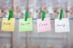 Messages written on a paper. Hanging on the clothesline royalty free stock photos