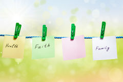 Messages written on sheets of paper on green background Stock Photography