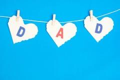 Messaggio del papà che pende dai pioli su una linea Immagine Stock Libera da Diritti