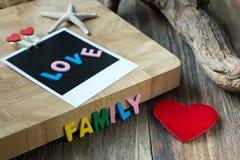 Messaggio della famiglia di amore sulla foto istantanea in bianco Fotografie Stock