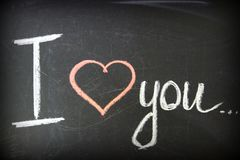 Messaggio di amore L'iscrizione sulla lavagna con gesso fotografie stock libere da diritti