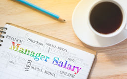 Messaggio di Salary del responsabile di concetto sul libro immagini stock