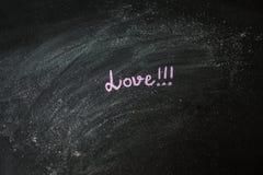 Messaggio scritto a mano su una lavagna: Amore Fotografia Stock Libera da Diritti