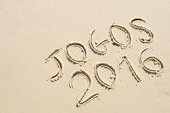 Messaggio semplice 2016 di Jogos scritto a mano sulla spiaggia di sabbia Fotografia Stock