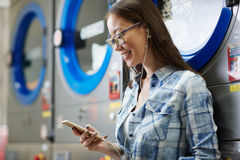 Messaging in laundromat Royalty Free Stock Images