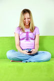 Messaging teen girl Royalty Free Stock Photography