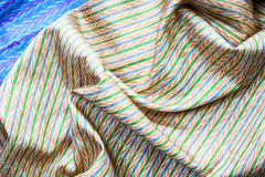 Messaline, satin. Golden silk as background for various applications Royalty Free Stock Image