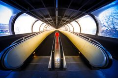 Travelator moving walkway tunnel dynamic perspective, Rollbahn stock photography