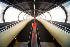 Travelator moving walkway tunnel dynamic perspective, Rollbahn royalty free stock photography