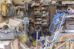 Messed garage detail. A messy garage detail filled with various things royalty free stock photos