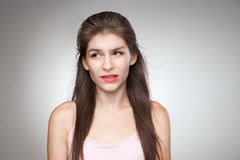Messed up girl biting her lips. royalty free stock photo