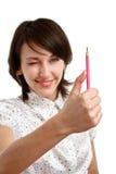 Messen mit einem Bleistift Lizenzfreies Stockfoto