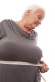 Messende Taille der fetten Frau Stockfotografie