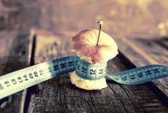 Messender Apfel der Magersuchtdünne Stockfoto